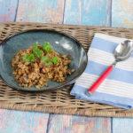 Reis mit getrockneten Tomaten und schwarzen Oliven