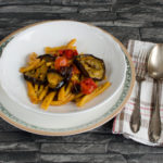 Aubergine, baked pasta with tomatoes