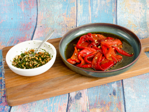 Sweet and sour peppers with pine nut crumble